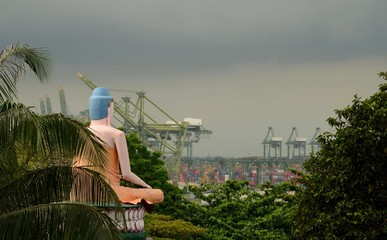 Seated meditating Buddha views busy container seaport