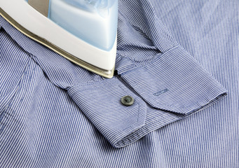 Steam iron on blue shirt