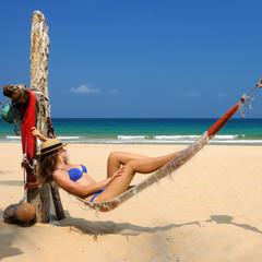 Woman in hammock on beach