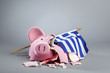 Robbed piggy bank with Greek flag