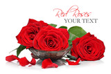 Red roses and petals in a wooden spa bowl
