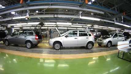 Workers do car complete set in assembly shop