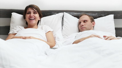 Wife and Husband  TV Remote control conflict in Bed