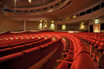red armchairs rows in auditorium