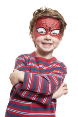 Young boy with face painting spiderman