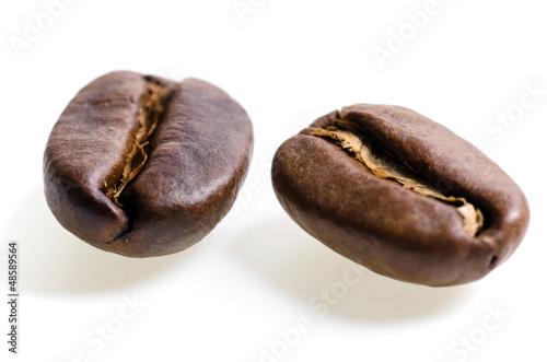 canvas print picture zwei Espressobohnen vor weißem Hintergrund