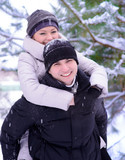 Young Beautiful Couple Taking Fun and Smiling Outdoors in Winter