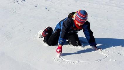 Girl writes on snow