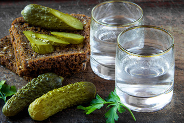 Russian vodka in small glass with black bread and pickles
