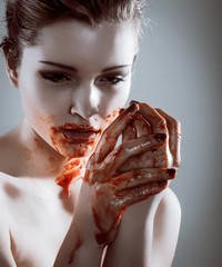 Closeup portrait of horror beautiful vampire woman with blood