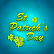 St. Patrick's Day greeting card with clover leafs on blue backgr
