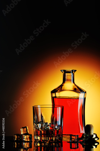 Bottle of whisky and glass