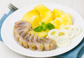 Herring fillet with potatoes and onions