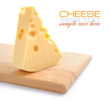 Piece of cheese on a wooden board on a white background