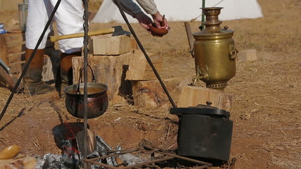 Cooking on the battlefield. Historical reenactment of 1812.