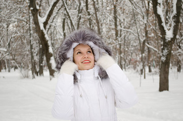 Girl in а White Winter Jacket with Hood