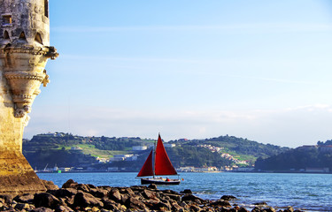 Red sailboat on Tejo river, Portugal