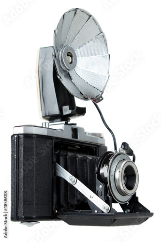 Vintage folding camera with bulb flash ,  isolated
