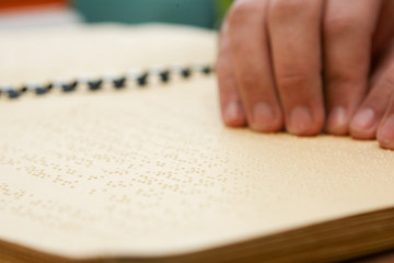 hand reading in braille