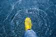 rubber boot splashing in the water - climate concept