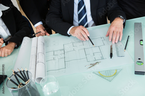 Architects discussing a blueprint