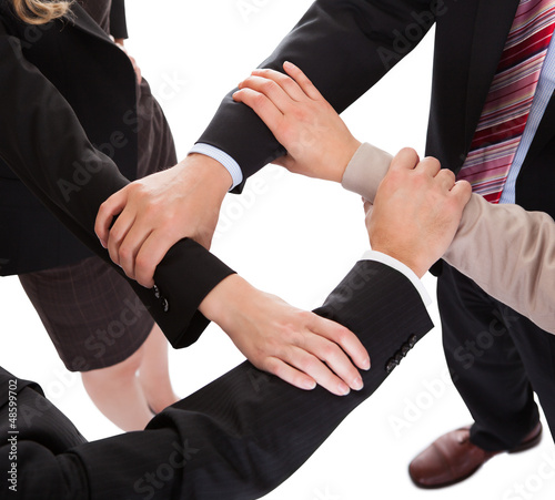 Businesspeople linking hands - teamwork