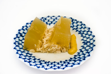 Jellied chicken on the plate with white background.
