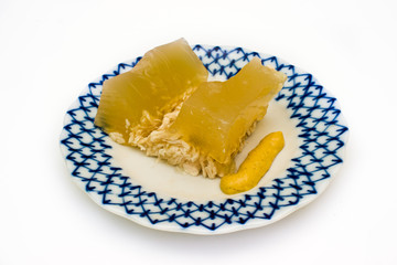 Jellied chicken in dish.