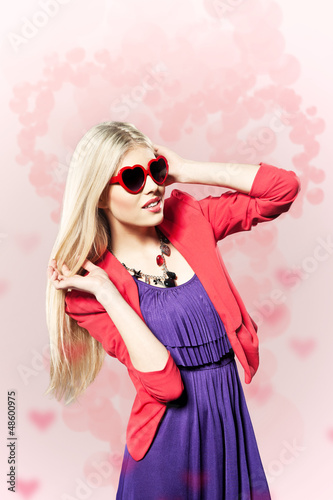 valentine's day young girl with heart shaped glasses