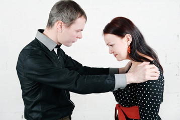 Man supporting sad woman