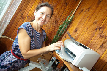 woman printing on the printer