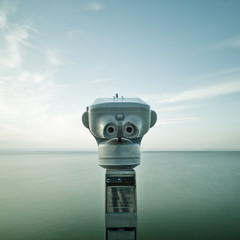 Binocular faced to the ocean