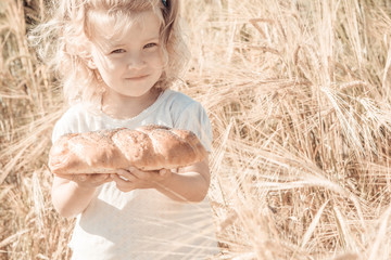 Little girl with tasty bread