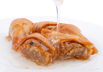Pour the syrup over the baklava