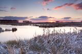sunrise over lake in winter