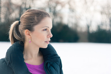 Closeup winter portrait of a beautiful young woman