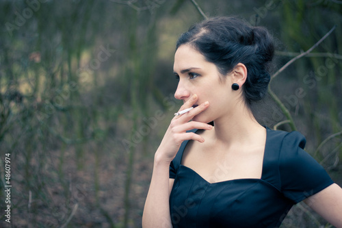 Portrait of a beautiful young woman smoking