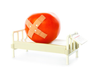 Tomato lies in hospital bed