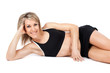 Attractive young fit woman lying on the floor
