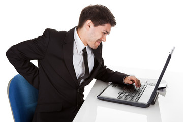 Businessman with lower back ache