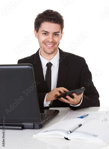 Young accountant making calculations
