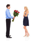 young man giving bunch of roses to a girl on valentine's day