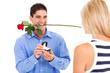 young man with rose and ring proposing to his girlfriend