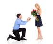 young man down on his knee proposing to girlfriend