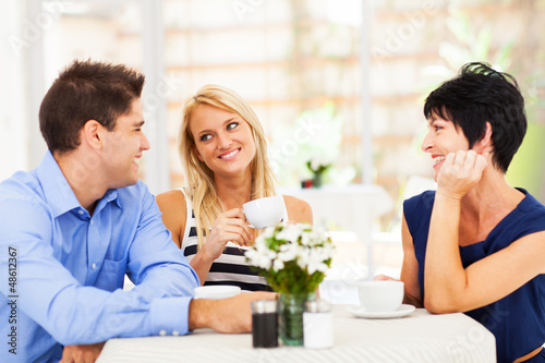 happy young man meeting mother in law with his wife