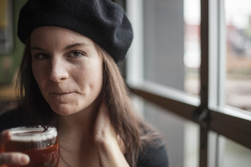Young Woman Drinking Inda Pale Ale