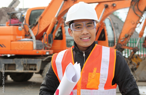 road construction worker front of excavator
