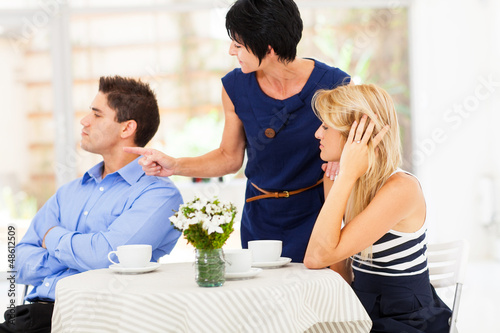 mother pointing finger at son-in-law