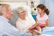 Granddaughter Visiting Grandmother In Hospital Bed