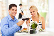young couple drinking wine in restaurant